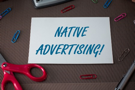 Text sign showing Native Advertising. Business photo showcasing Online Paid Ads Match the Form Function of Webpage Scissors and writing equipments plus plain sheet above textured backdrop