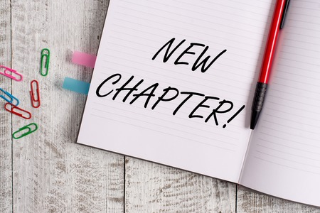 Conceptual hand writing showing New Chapter. Concept meaning Starting ultimately something goals created in your mind Notebook stationary placed above classic wooden backdrop