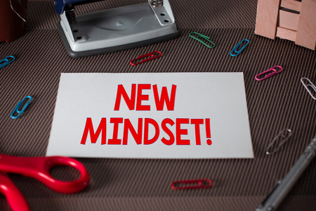 Text sign showing New Mindset. Business photo text mental attitude of demonstratings responses to certain situations Scissors and writing equipments plus plain sheet above textured backdrop
