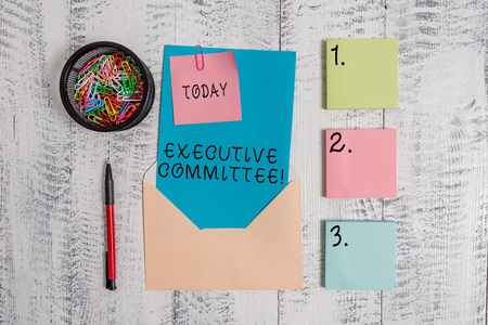 Writing note showing Executive Committee. Business concept for Group of Directors appointed Has Authority in Decisions Envelope letter sticky note ballpoint clips on wooden background