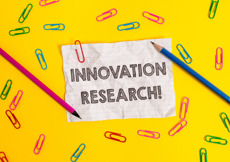 Conceptual hand writing showing Innovation Research. Concept meaning Existing Products Services come into New Being Blank crushed paper sheet message pencils colored background