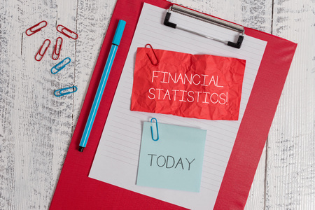 Word writing text Financial Statistics. Business photo showcasing Comprehensive Set of Stock and Flow Data of a company Clipboard paper sheet crushed sticky note clip marker wooden background Foto de archivo