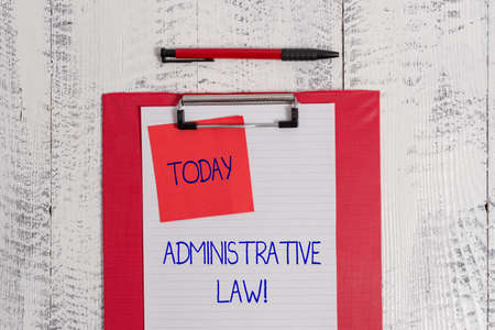 Writing note showing Administrative Law. Business concept for Body of Rules regulations Orders created by a government Clipboard paper sheet sticky note ballpoint vintage wooden background