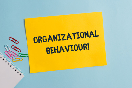 Text sign showing Organizational Behaviour. Business photo showcasing the study of the way showing interact within groups Plain cardboard and writing equipment placed above pastel colour backdrop 版權商用圖片 - 124598319