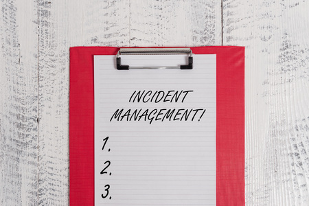 Text sign showing Incident Management. Business photo text Process to return Service to Normal Correct Hazards Colored clipboard blank paper sheet old retro wooden vintage background