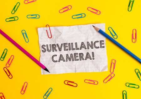 Conceptual hand writing showing Surveillance Camera. Concept meaning Closed Circuit Television transmit signal on monitors Blank crushed paper sheet message pencils colored background
