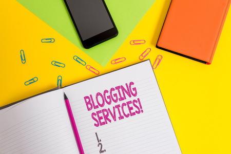 Handwriting text Blogging Services. Conceptual photo Social networking facility Informative Journalism Blank paper sheet pencil clips smartphone two notepads colored background