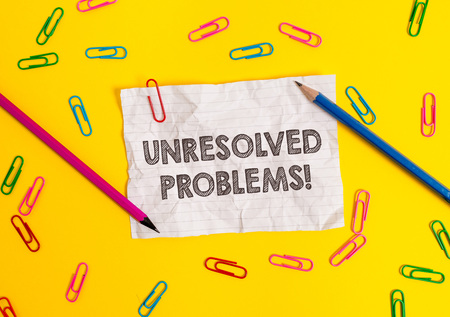Conceptual hand writing showing Unresolved Problems. Concept meaning those Queries no one can answer Unanswerable Questions Blank crushed paper sheet message pencils colored background