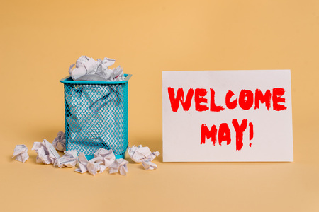 Handwriting text Welcome May. Conceptual photo welcoming fifth month of year usually considered summer crumpled paper trash and stationary with empty paper placed in trash can Stock Photo