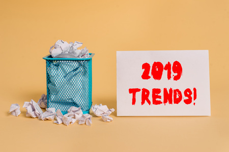 Handwriting text 2019 Trends. Conceptual photo general direction in which something is developing or changing crumpled paper trash and stationary with empty paper placed in trash can