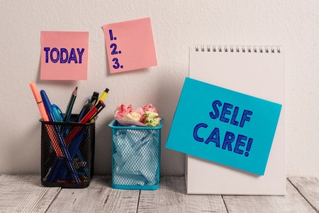 Writing note showing Self Care. Business concept for practice of taking action preserve or improve ones own health Sticky Notes Card on Wall Spiral Notebook 2 Mesh Pencil Pots Work Desk 스톡 콘텐츠