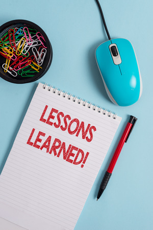 Text sign showing Lessons Learned. Business photo text experiences distilled project that should actively taken Notebook and writing equipment with computer mouse above pastel backdrop