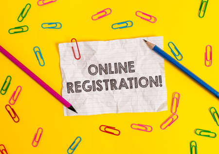 Conceptual hand writing showing Online Registration. Concept meaning Process to Subscribe to Join an event club via Internet Blank crushed paper sheet message pencils colored background