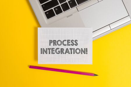 Handwriting text writing Process Integration. Conceptual photo Connectivity of Systems Services and Information Top trendy metallic laptop pencil squared paper sheet colored background