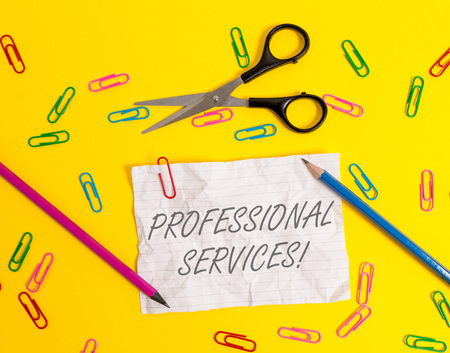 Writing note showing Professional Services. Business concept for offer Knowledge based help some require Licensed Crushed striped paper sheet scissors pencils clips colored background
