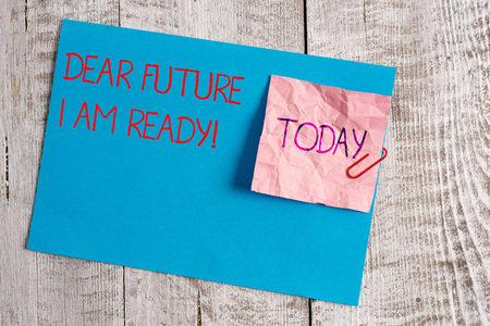 Handwriting text Dear Future I Am Ready. Conceptual photo state action situation being fully prepared Wrinkle paper and cardboard plus stationary placed above wooden background