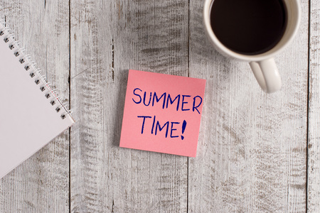 Word writing text Summer Time. Business photo showcasing achieve longer evening daylight summer setting clocks hour ahead Stationary placed next to a cup of black coffee above the wooden table