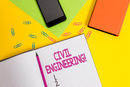 Handwriting text Civil Engineering. Conceptual photo Planning Design Building of roads bridges public buildings Blank paper sheet pencil clips smartphone two notepads colored background Banco de Imagens