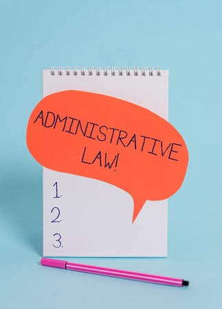 Handwriting text writing Administrative Law. Conceptual photo Body of Rules regulations Orders created by a government Standing blank spiral notepad speech bubble pen lying cool background 스톡 콘텐츠