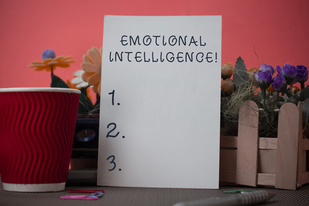 Handwriting text writing Emotional Intelligence. Conceptual photo Self and Social Awareness Handle relationships well Flowers and stationary plus plain sheet with paper big cup above a table Imagens - 124382647