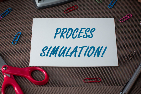 Text sign showing Process Simulation. Business photo showcasing Technical Representation Fabricated Study of a system Scissors and writing equipments plus plain sheet above textured backdrop