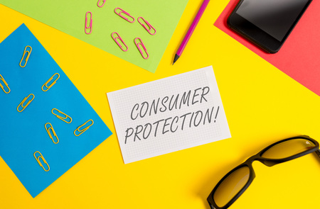 Text sign showing Consumer Protection. Business photo text Fair Trade Laws to ensure Consumers Rights Protection Paper sheets pencil clips smartphone eyeglasses notebook color background