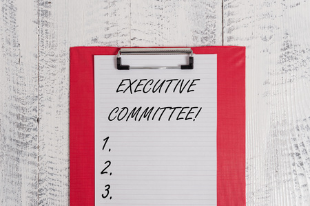 Text sign showing Executive Committee. Business photo text Group of Directors appointed Has Authority in Decisions Colored clipboard blank paper sheet old retro wooden vintage background Stock Photo