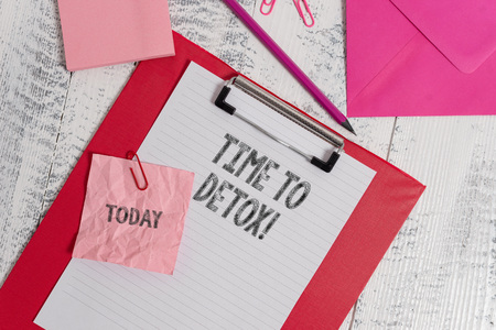 Handwriting text writing Time To Detox. Conceptual photo when you purify your body of toxins or stop consuming drug Clipboard sheet pencil crushed note envelope clips notepad wood background
