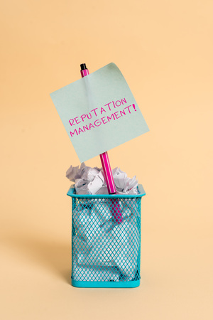 Conceptual hand writing showing Reputation Management. Concept meaning Influence and Control the Image Brand Restoration crumpled paper and stationary with paper placed in the trash can