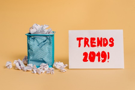 Handwriting text Trends 2019. Conceptual photo general direction in which something is developing or changing crumpled paper trash and stationary with empty paper placed in trash can
