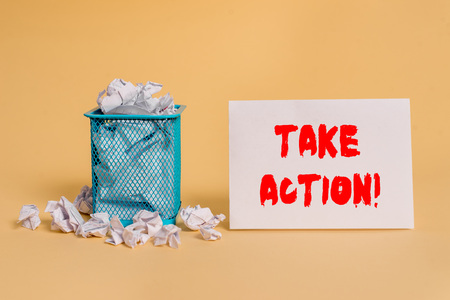 Handwriting text Take Action. Conceptual photo do something official or concerted to achieve aim with problem crumpled paper trash and stationary with empty paper placed in trash can Stock Photo
