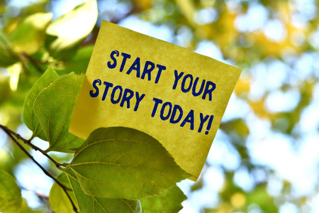 Word writing text Start Your Story Today. Business photo showcasing work hard on yourself and begin from this moment Piece of square paper use to give notation on tree leaf under sunny day Banco de Imagens