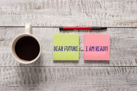 Text sign showing Dear Future I Am Ready. Business photo text state action situation being fully prepared Stationary placed next to a cup of black coffee above the wooden table