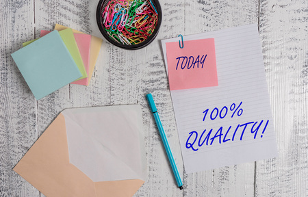 Handwriting text writing 100 Percent Quality. Conceptual photo Guaranteed pure and no harmful chemicals Top Excellence Envelope sheet paper sticky note pads pen clips holder wooden background Stock fotó