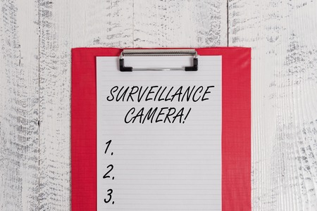 Text sign showing Surveillance Camera. Business photo text Closed Circuit Television transmit signal on monitors Colored clipboard blank paper sheet old retro wooden vintage background