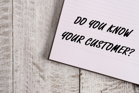 Conceptual hand writing showing Do You Know Your Customer Question. Concept meaning service identify clients with relevant information Notebook stationary placed above classic wooden backdrop