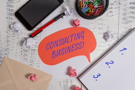 Writing note showing Consulting Business. Business concept for Consultancy Firm Experts give Professional Advice Smartphone pen clips envelope sheet speech bubble paper balls notebook