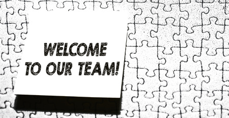 Word writing text Welcome To Our Team. Business photo showcasing introducing another demonstrating to your team mates Piece of square note paper use for give notation stick to puzzle background