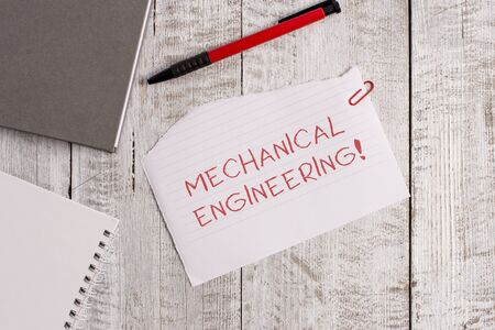 Handwriting text Mechanical Engineering. Conceptual photo deals with Design Manufacture Use of Machines Torn paper and notebook sheet with a pen placed on top of wooden table Imagens - 124401240