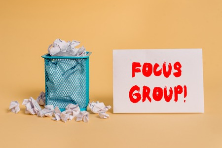 Handwriting text Focus Group. Conceptual photo showing assembled to participate in discussion about product crumpled paper trash and stationary with empty paper placed in trash can