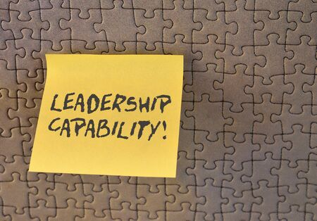 Writing note showing Leadership Capability. Business concept for what a Leader can build Capacity to Lead Effectively Square paper piece notation stick to textured glass window
