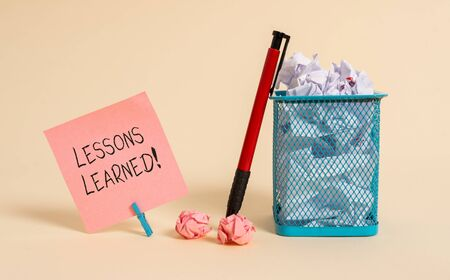 Word writing text Lessons Learned. Business photo showcasing experiences distilled project that should actively taken Plain note paper and stationary placed above soft pastel colour backdrop Stock Photo