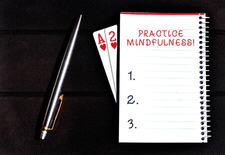 Conceptual hand writing showing Practice Mindfulness. Concept meaning achieve a State of Relaxation a form of Meditation Writing equipments placed next to a gadget vintage lantern Imagens - 124401274