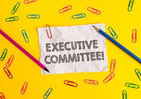 Conceptual hand writing showing Executive Committee. Concept meaning Group of Directors appointed Has Authority in Decisions Blank crushed paper sheet message pencils colored background