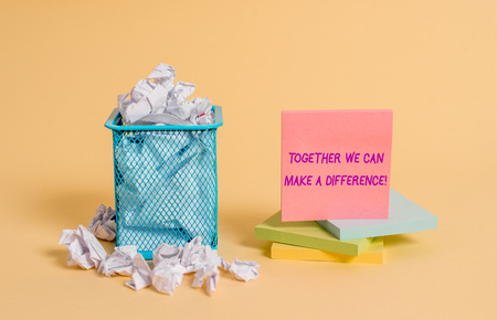 Conceptual hand writing showing Together We Can Make A Difference. Concept meaning be very important some way in like team or group crumpled paper and stationary paper placed in the trash can