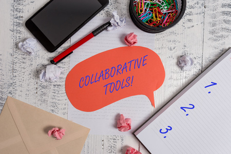 Writing note showing Collaborative Tools. Business concept for Private Social Network to Connect thru Online Email Smartphone pen clips envelope sheet speech bubble paper balls notebook