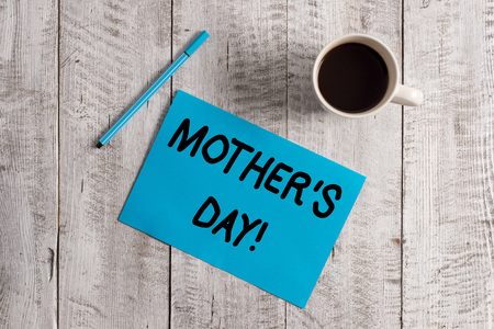 Conceptual hand writing showing Mother S Day. Concept meaning day of year where mothers are particularly honoured by children Pastel Colour paper and pen with coffee cup on wooden table 写真素材
