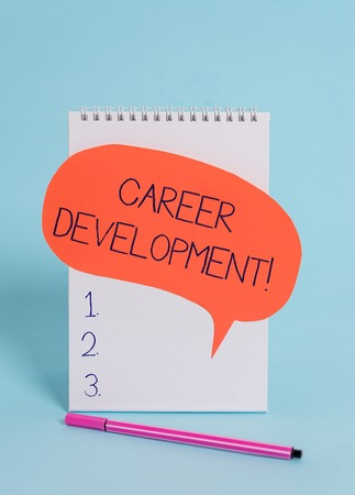Handwriting text writing Career Development. Conceptual photo Lifelong learning Improving skills to get a better job Standing blank spiral notepad speech bubble pen lying cool background