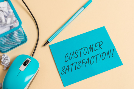 Writing note showing Customer Satisfaction. Business concept for Exceed Consumer Expectation Satisfied over services crumpled paper trash in bin placed next to modern gadget and stationary