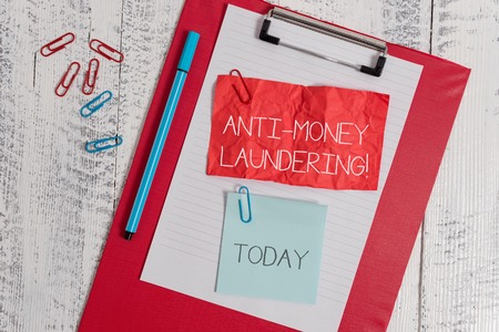 Word writing text Anti Money Laundering. Business photo showcasing stop generating income through illegal actions Clipboard paper sheet crushed sticky note clip marker wooden background